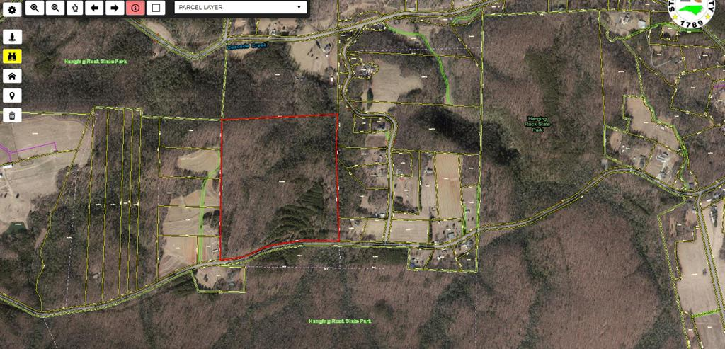 Wooded tract with road frontage, across the road from State Park Land. Creek, rolling topography with nice wide ridge. Perfect for a homesite near Hanging Rock State Park.