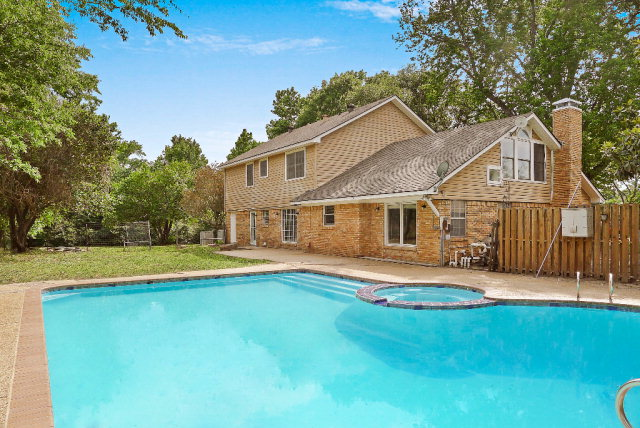 Large 5 Bed 2.5 Bath on just under 2.5 acres with a gunite pool and fenced backyard.  All 2,848 sq feet are light, bright & remodeled-it feels like a new house! Beautiful brand new island-style kitchen with granite counter tops, glass tile back splash and modern pendant lighting. Large master bedroom with ensuite bath and walk-in closet.  Fantastic floorplan with 2 living spaces, formal dining room, tons of storage, extra large laundry room, 2-car garage, brick fireplace and WBFP.  New high end appliances included. Other updates include: new pool equipment, new pool plaster, new light fixtures, new bath cabinets, flower beds, new garage door openers, fresh designer paint colors throughout, new floors & so much more! It's got it all!