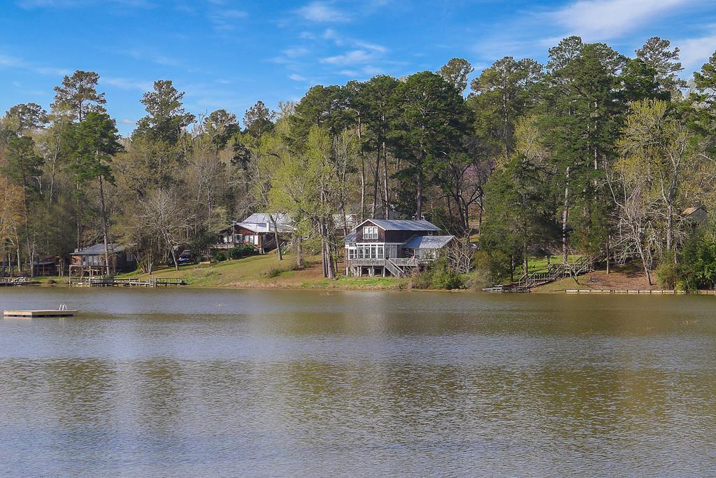 Owner financing Available! Come live the lake life in this pinterest-worthy show stopper on Lake Mary w/ two lots! Open concept living area w/ insane lake front views, custom rock fireplace & custom built-in storage. Island Kitchen w/ granite countertops, shaker cabinets & farmhouse apron sink. Master bdrm has tall ceilings, built-in wardrobe &opens to gorgeous lake view.  Downstairs bath has ceramic tile throughout, tub & shower & custom antique vanity. Upstairs bath has clawfoot tub/shower combo & b&w ceramic tile. Sunroom that overlooks the lake, large back patio, storage building, metal roof & huge laundry room. Property comes completely furnished & ready to go! Lake Mary is a small 14 acre private membership-only lake association.