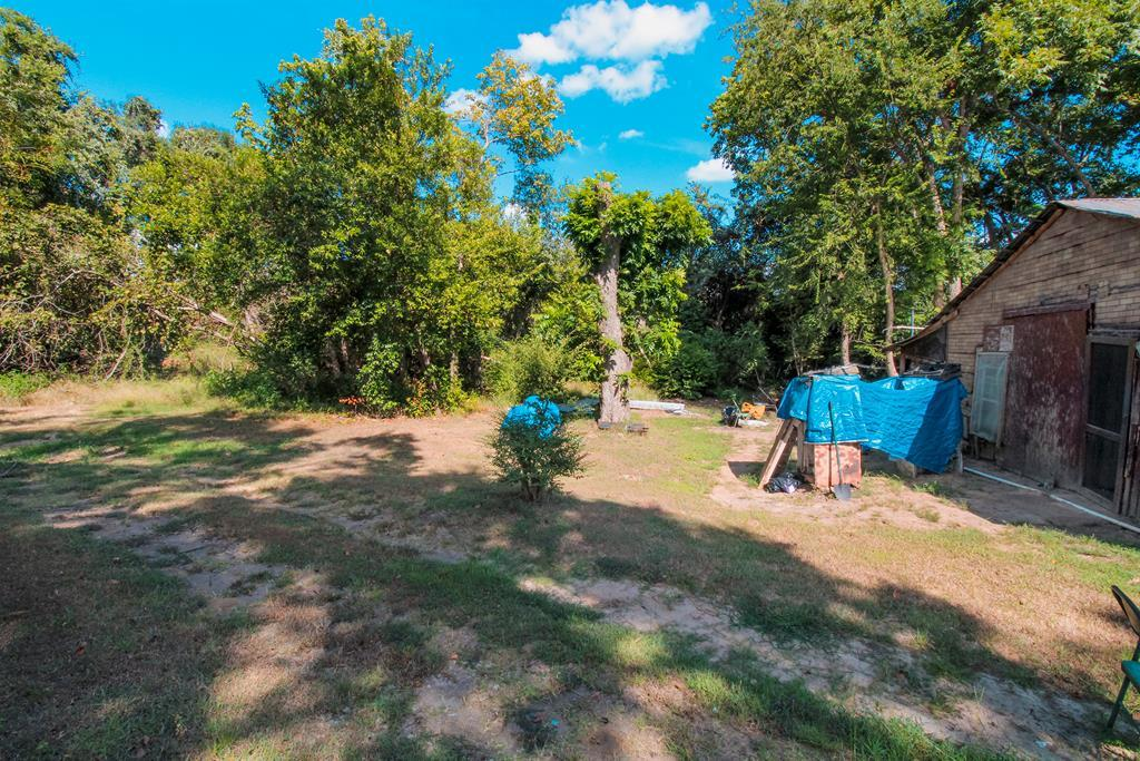 3.31 Acres with Frontage on FM 320. Mostly thick wooded acreage with a home-site clearing on the front. Backs up to adjoining property owned by UT Tyler and near upper/lower lake. Utilities and septic on site. There is an as-is house on the property with little value that is in disrepair and showings inside the house are unavailable at this time. There is a spot for a pond that has been dug out behind the house, but is currently dry. Bring offers!