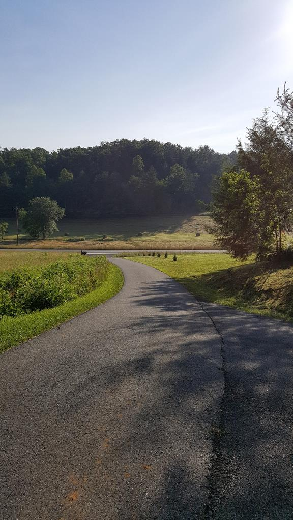Loads of potential with this excellent large tract.  Great views from large long ridge line at top of property.  8 lots already surveyed.  Would be great for development or private tract.  Paved road going into property.  Great location near Lake Hiwassee and Cherokee lake.