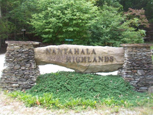 LAKE FRONT LOT IN NANTAHALA HIGHLANDS!   This lot has a 4 Bedroom septic permit!  Gated, great view!  Easy access-underground utilities, share water from well, road well maintained.  Dont miss out on your piece of paradise!  Close to Appalachian trail, Wayah Bald and whitewater rafting!  Perfect spot to build your forever home or weekend retreat!