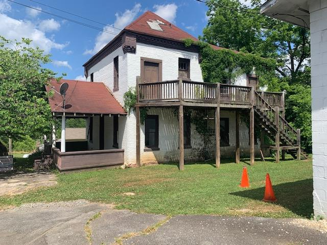 The first jail in the history of Graham County makes this property truly historical. Located in the center of Robbinsville the structure is ideally suited for a duplex or a professional office. Property is priced to sell. Make offer. Building is vacant ready for remodel.