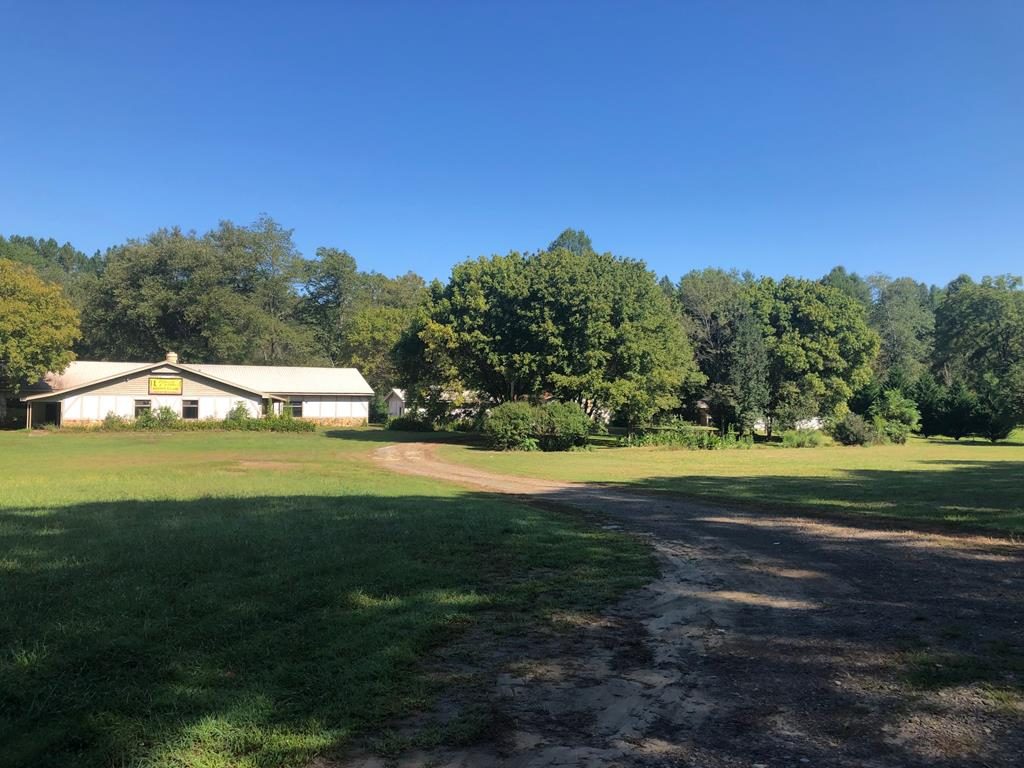 Great commercial opportunity on the Nottley River! Property includes home, separate garage, maintenance building and dance club building. Over 500ft of river frontage, convenient to town and Hwy. 64/74...perfect set up for a upscale RV park.