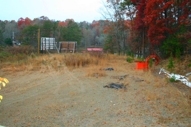 Level Lot!  App. 100+/- feet of Hwy. 64 road frontage. Property has sewer tap already paid for and also city water tap also paid for .