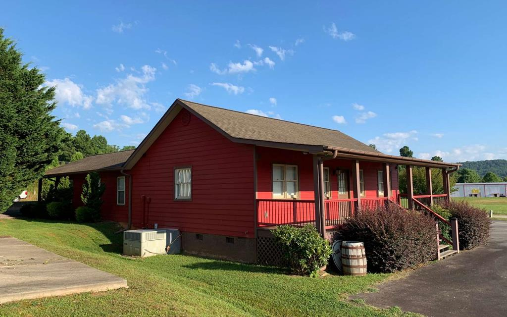 STOP PAYING RENT!!!! OFFICE BUILDING IN HIGH TRAFFIC COUNT AREA! Located between Hayesville, NC and Hiawassee & Young Harris, GA, this stand alone building offers 9 separate offices, conference rooms, partial kitchen area, 1 half bath and 1 full bath, front covered porch & a back covered concrete patio. Perfect for any type of business.