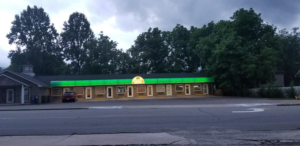 Nice little 7 room motel with laundry room, 8'x 16' covered patio deck, 6' overhang plus 3' lighted canopy/sign..It's called Lilypad Suites . Conveniet downtown location with lots of parking.