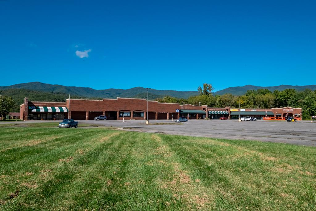 Endless possibilities! Commercial complex in Downtown Andrews, NC! Gorgeous mountain views surround this massive building, with a prime location. Multiple tenants already in place, commercial opportunities abound. TONS of parking here, and right in the middle of everything!