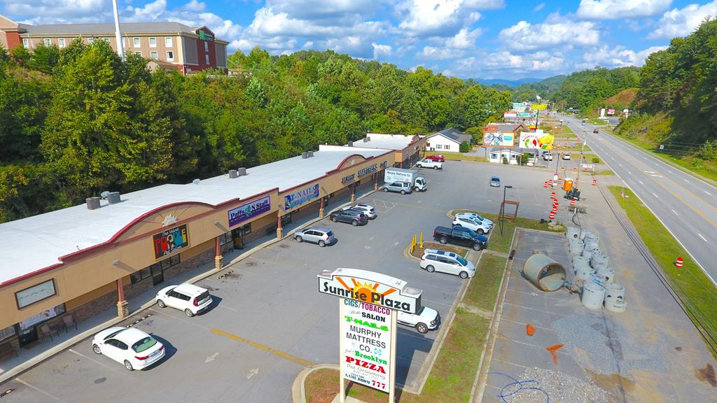 Strip Mall with ten fully occupied units with busy highway frontage on US Hwy 64 in Murphy. Great visibility and good tenants. MLS 136351 restaurant building next door is also available