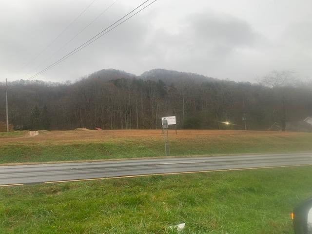 This is a vacant site with public water and sewer available, located on the busiest highway in Cherokee County.  Commercial Possibilities are unlimited with ample frontage and location.