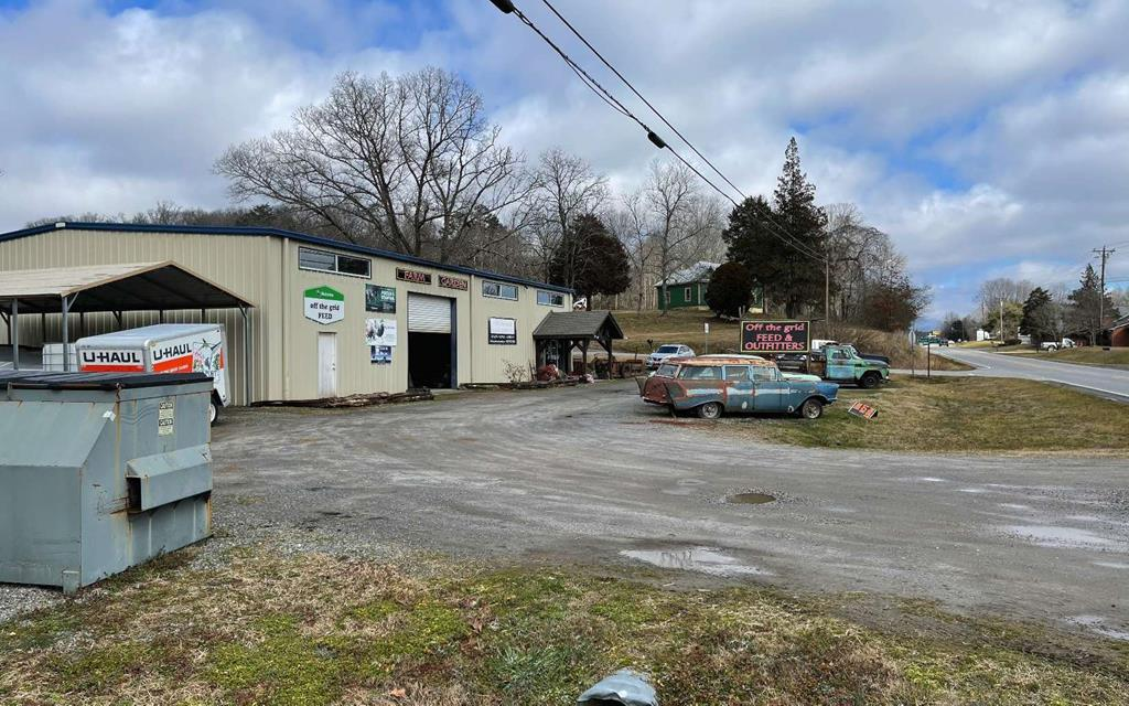 GREAT COMMERCIAL OPPORTUNITY! SALE NOW INCLUDES THE BUSINESS, INVENTORY, EQUIPMENT AND THE NAME.  Located in a high traffic area on Hwy 64 between Hayesville, NC and Murphy, NC, this building offers a large open warehouse area, a retail area with a restroom, and an upper level with 3 separate office areas.