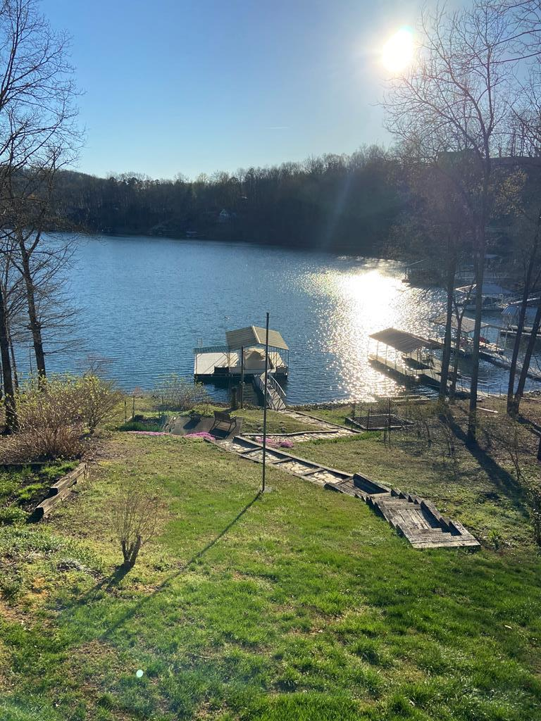 rightCome to the Lake Chatuge in the mountains of North Carolina! Now is the time to buy and get ready for summer! This is the perfect lake lot, gentle slope and room for gardens, blue berries are blooming! You will have endless fun on the covered dock with a swim platform, not to mention the beautiful views of Lake Chatuge from most every room of this house. Located on quiet dead end street, in a small neighborhood of nice homes. This home is immaculate and well maintained. A new addition master bedroom, master bath, and closet. Upgrades include hickory floors, vinyl clad windows, new paint inside and out, cambria countertops.Detached garage and circular driveway allow for plenty of parking