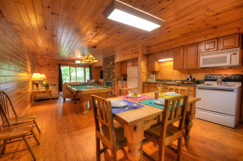 Prepare to fall in love! MINUTES AWAY FROM THE NANTAHALA OUTDOOR CENTER! Warmth & Elegance abound in this cabin. This duplex is tucked back in the woods in the Nantahala Village Resort and can be rented as 4 separate units for maximum income potential. This charming mountain cabin is fully furnished & features a full kitchen, 2 Full bath w/ tub/shower combo, handicap accessible, pool table & wood floors. Sit under your covered porch, 1 of 3 balconies, grill out and enjoy the clean mountain air. Fantastic location for fishing, hiking & whitewater rafting. A MUST SEE and GREAT rental potential!