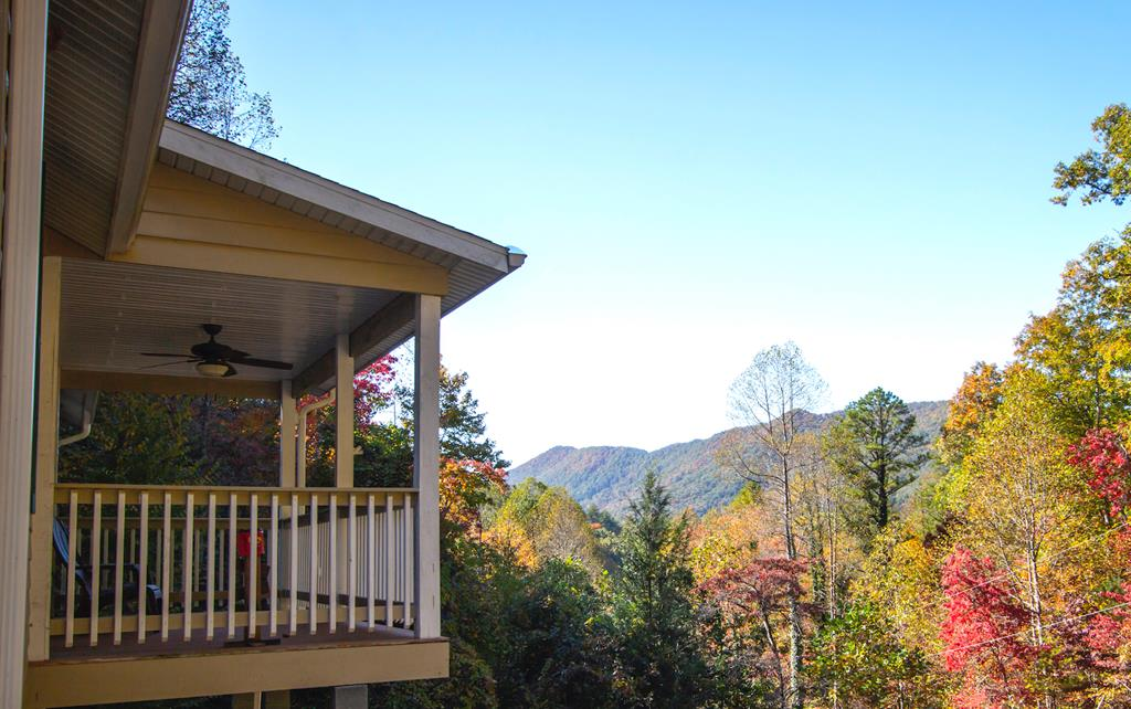Sunset Views, complete privacy and turnkey ready! Two bedrooms & 2 Baths on 1.92 acres. Spacious living area w/ wood stove leads to covered porch to watch the sun set over the Yellow Creek Mtns. Easy access, no crazy roads & plenty of parking/ turnaround. Located in a quiet community. Close to all the recreation you crave in a vacation home and also suitable for full time living. Large Master Suite and separate laundry room, great closet spaces. Downstairs has 2nd living area & bonus room used as a 3rd bedroom and outside access. Single garage and added storage room to keep the toys safe and handy! Has been an excellent short term rental. Call or text Kate  828. 735.2101 for more info.