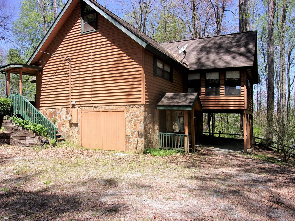 High Elevation Mountain Chalet with seasonal views of nearby Lake Nantahala, Borders USFS & is within minutes of Rocky Branch Lake Access area, Appalachian Trail, and White Water Rafting & Trophy Fishing on the Nantahala River ! Ridgetop location surrounded by Trees with decks and porches to sit out and enjoy the NC Mountains. This home features a spacious Great Room with stone Fireplace and lots of windows. Just off of the Great Room is the Sun Room with views of the woodland setting. Bedrooms on three levels including a loft bedroom, bedroom with walk-in closet on main and a bedroom and full bath in the partially finished basement. Owner previously had internet service with Frontier Comm.