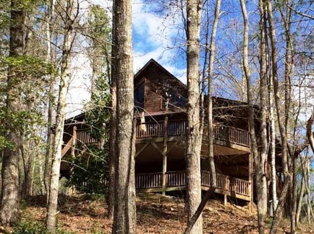 Seller says BRING ANY REASONABLE OFFER!  Secluded location for this chalet get away!  A short walk to Appalachia Lake, you can see the lake through the trees.3rd sleeping bonus area in basement. Rich wood interior,two fireplaces,plenty of light,Italian marble tile floors in bths. Full finished basement.If you want a place to truly get away from it all...this is it.Seller also owns another beautiful creek front acre below,and will sell separate.Seller reports private well is 17 gal a minute.This chalet is a short walk to a water fall. True mountain living!