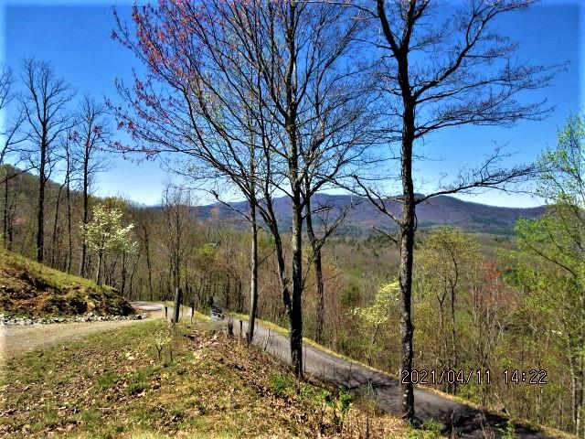 Amazing view lot, ready to build!  VIEWS in both directions, watch the sunrise and the sunset from the front of your home and the back deck. Paved roads, shared well, 3 bedroom septic in place, underground utilities. Elevation is over 2400' with easy access. Quiet neighborhood, close to town. Possible owner financing.