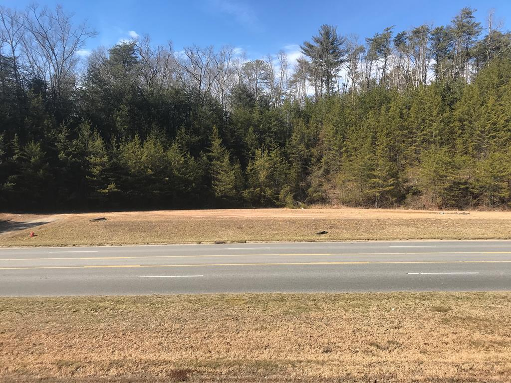 1.48+/-Ac Prime location! Commercial Property! Awesome parcel with improvements. Only 1.6 miles from Harrah's Cherokee Casino & Resort! Septic installed, along with curbing and two driveways. Land is level and cleared, with busy road frontage! Additional information available on request. Great location for retail business.