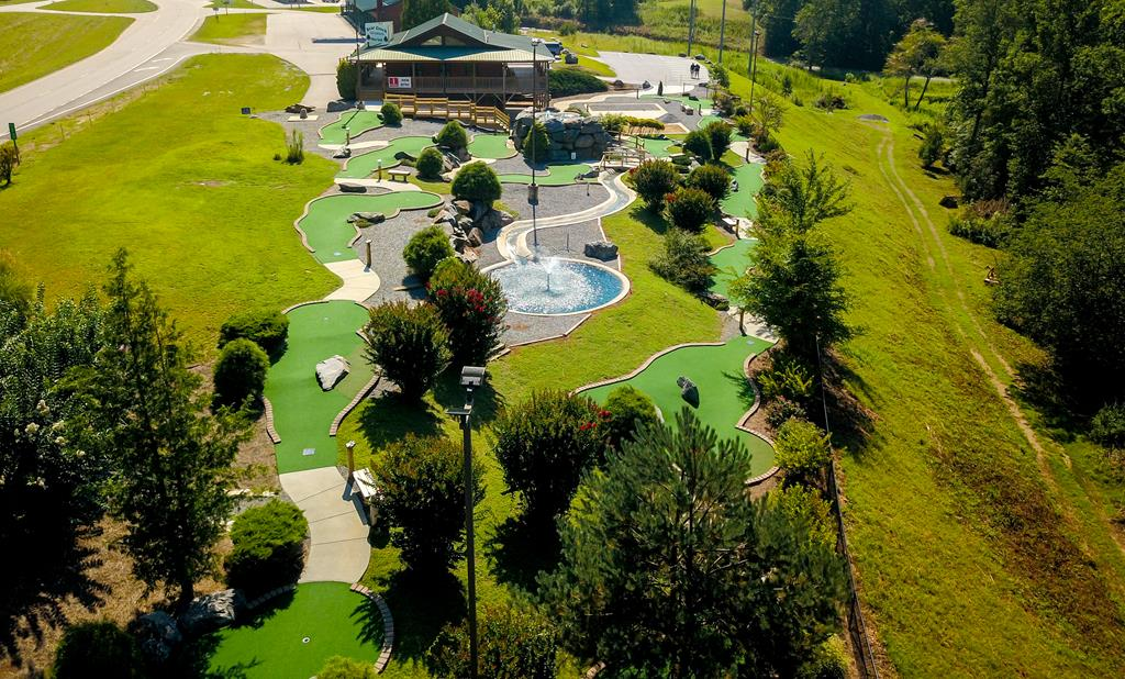 Excellent opportunity to own a well-known family fun center on 7.78 acres with 18-Hole Miniature Golf Course and Gem Mine.Turnkey operation and family owned.Main building is 2368 sq ft and features 2 bathrooms,office and large reception area where ice cream and refreshments are served.Finished lower level that leads out to Golf Course & Gem Mine and ideal for hosting parties.Building has a wrap around rocking porch deck that overlooks the grounds.Back part of property has a road in that takes you to top section where you can easily build additional cabins or private residence.Behind property is a creek and plenty of room to expand services.Location is high visibility on main tourism route.