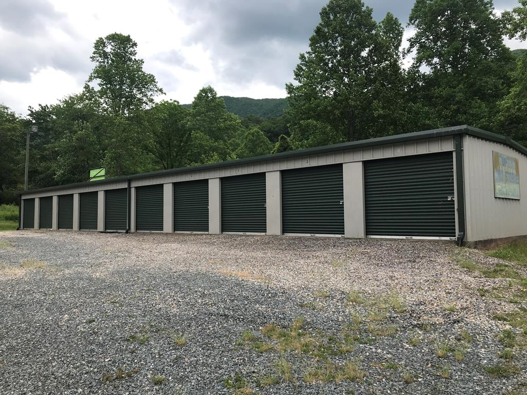 STORAGE UNITS FOR SALE on a creek! Located near the Nantahala River, This property has 20, 10ftx10ft storage units on slab with power, along with an extra lot for more if desired. Come see today!