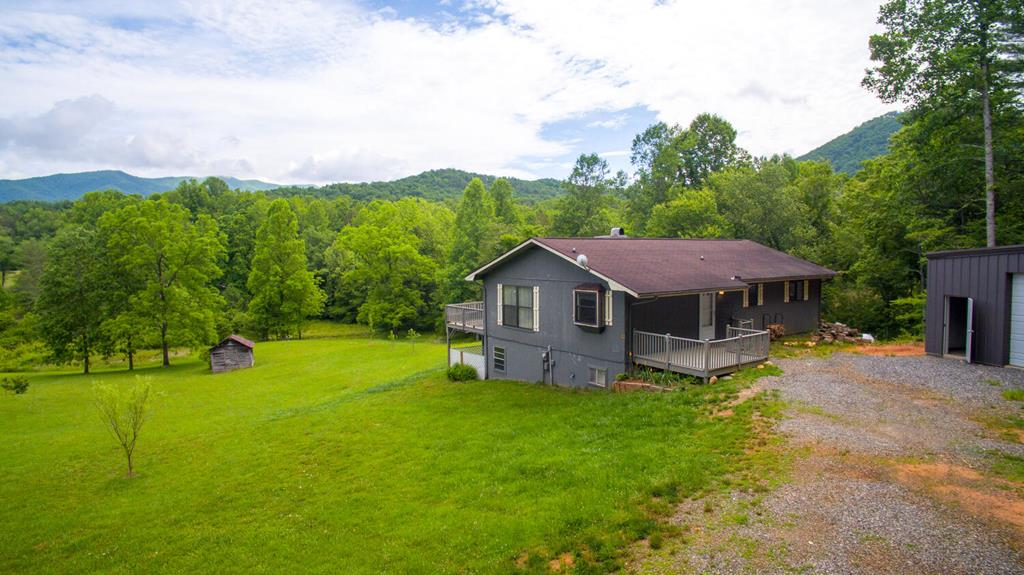 Must See!! 2/2 mountain home in Winchester Cove which is part of the the Beautiful Tusquittee Valley. This property has so much potential. Extremely easy access, year round views to get the most out of all seasons, small branch on the property. Great location, just a few miles from Hayesville, a couple miles to great trout fishing, tubing or kayaking in the Tusquittee Creek or Hiawassee River, and only about 6 miles to Lake Chatuge!! Full unfinished basement for expansion if needed, usable land, basically new huge metal building for all the toys! No restrictions on this land, do not miss this one!!