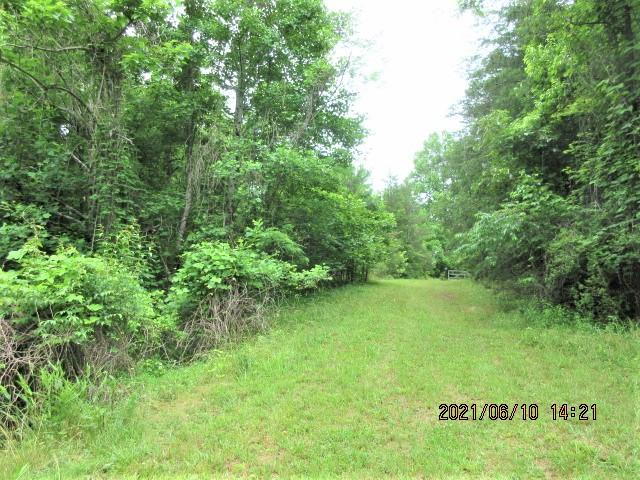 Unrestricted Lot with Highway frontage, easy access and close to town. There is a spring on the property, partially wooded with shared road going up to back side of the lot. Additional 1.80 ac lot also for sale that adjoins this lot. Lots of possibilities, commercial use, storage or park your camper. Purchase both lots for a discounted price.