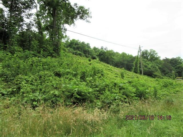 Unrestricted! 1.80 ac. lot with highway frontage, adjoins 1.30ac. lot  MLS 138161. Close to town, easy access. Lot is partially wooded with shared road going up to back of property. Lots of possibilities, can be commercial use, storage or park your camper.