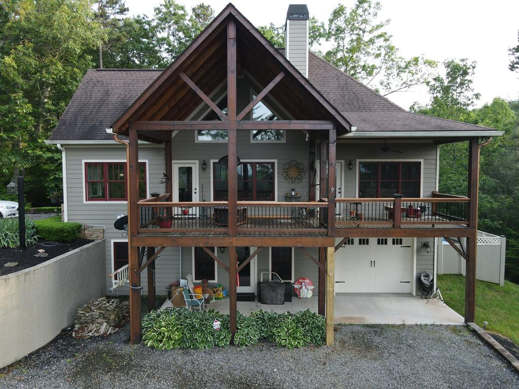 This gorgeous Estate is located in a lovely gated, subdivision. As you drive up the paved road, you will be amazed by the long-layered view of the beautiful Western, NC mountains. On the main terrace, you will find an open-concept kitchen, with the right amount of cabinetry. The dining area is perfect for entertaining guests and is only a few steps away from the cozy living room that features a fire place. The master on the main, has a  has a full bath and door that opens right up to the deck so that you can take in the view. Down the staircase is a full bsmt with plenty of office space, closets, living room area, bedroom, full bath and easy access to the garage. Plenty of room for storage!
