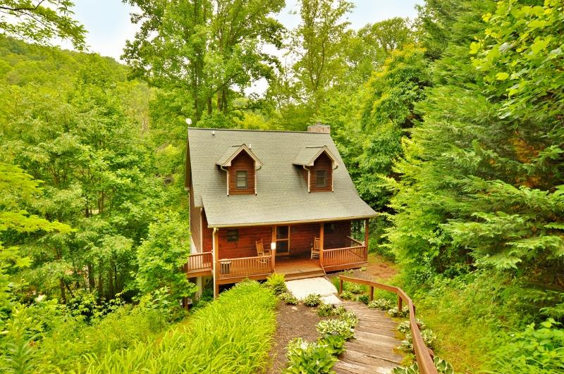 A MUST SEE!  ONE OF A FEW LAKE FRONT HOMES ON BEAUTIFUL NANTAHALA LAKE.  Well constructed 3 level Chalet has spacious living room with beautiful wood burning fireplace, dining area and well planned kitchen , cathedral ceiling, guest bedroom, bath, storage all leads out to covered porch to enjoy surroundings, UPSTAIRS has master bedroom, spacious bath with jetted tub, storage, laundry, unique gas log fireplace, glass doors leads to private covered porch.  LOWER LEVEL has large unfinished room stubbed for bath with covered porch.  DOCK TO ENJOY ALL WATER SPORTS, central air & heat, wood or tile floors throughout, BEAUTIFULLY FURNISHED, EXCELLENT RENTAL HISTORY!  CALL FOR AN APPOINTMENT TODAY1!