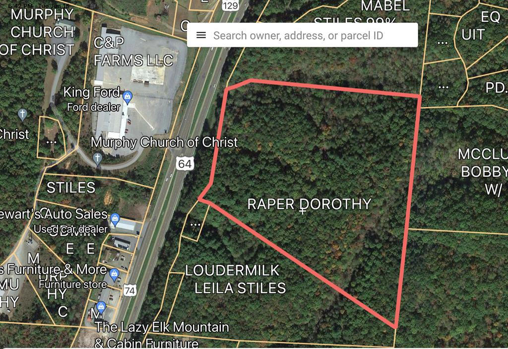 A rare find is here! Nearly 25 acres directly across from King Ford on 64 has city water, power, is unrestricted, many roads are already in place, and great access. The potential is endless! It would make excellent commercial or residential. Looking to create a community close to town? This could be it! Have a business idea and need a place for it? You can't beat the location! Looking for a private estate with extraordinary access and excellent homesites? You'll never find another like it! Easy to walk and drive, you'll be amazed by this property. Give us a call for more details or to come look at it today!