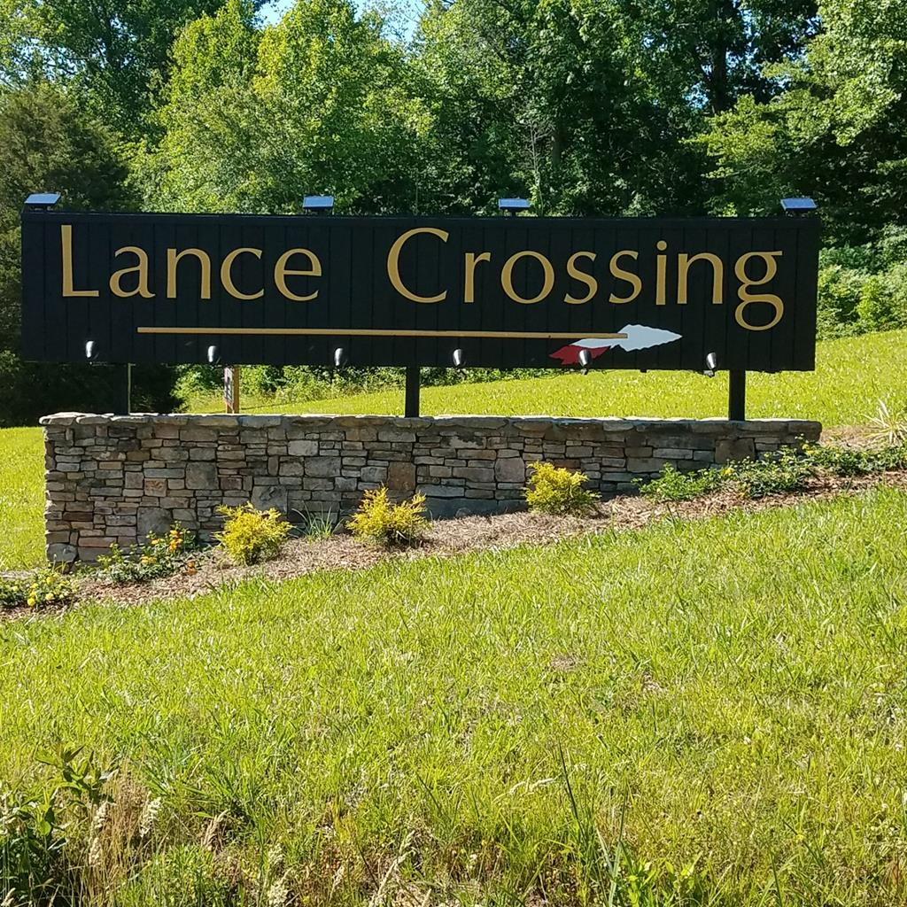 Nicely wooded, gentle laying lot in beautiful Lance Crossing.  Mature timber, very private, excellent building site with driveway already pushed onto lot.  Paved roads throughout for easy access, Notla Water available.  Conveniently located just minutes to downtown Blairsville, GA and Murphy, NC.  Also just a short drive to Lake Nottley and Lake Hiwassee, hiking, whitewater rafting and plenty of other local area attractions.