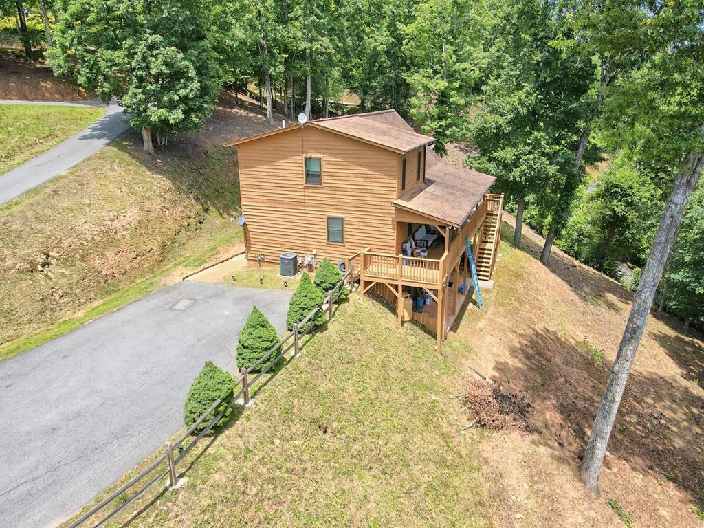 GORGEOUS chalet in North Oak Estates! Full paved driveway makes for easy access. Outside youll enjoy the wide fire pit or any of the many covered porches or deck. Inside, the Great Room boasts hardwood flooring with a stone fireplace that stretches to the vaulted wood ceiling. The open floor plan provides great entertaining with kitchen/dining/living area on main floor along with guest bed, bath and laundry area. Soft carpet leads you upstairs to your master suite with private bath and walk-in closet. The fully finished lower level is set for fun! Rec room complete with gas stove, spacious bedroom and full bathroom with its own outdoor patio. Come home to the mountains!