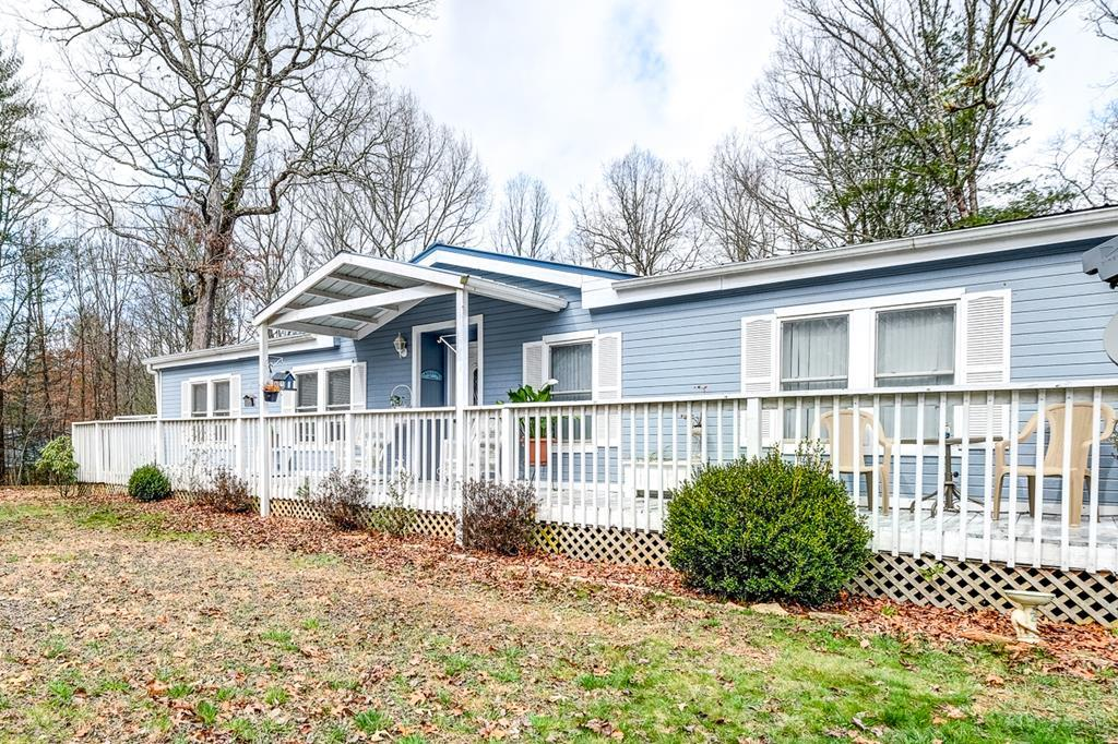 This 3/2 manufactured home has many extras!  Beautiful updated kitchen and master bathroom.   1.26 acres of useable land  with 24 X 35 carport and storage buildings, fenced yard, garden spot & RV hook up and private well.  Great location with all paved access and Fiber internet.