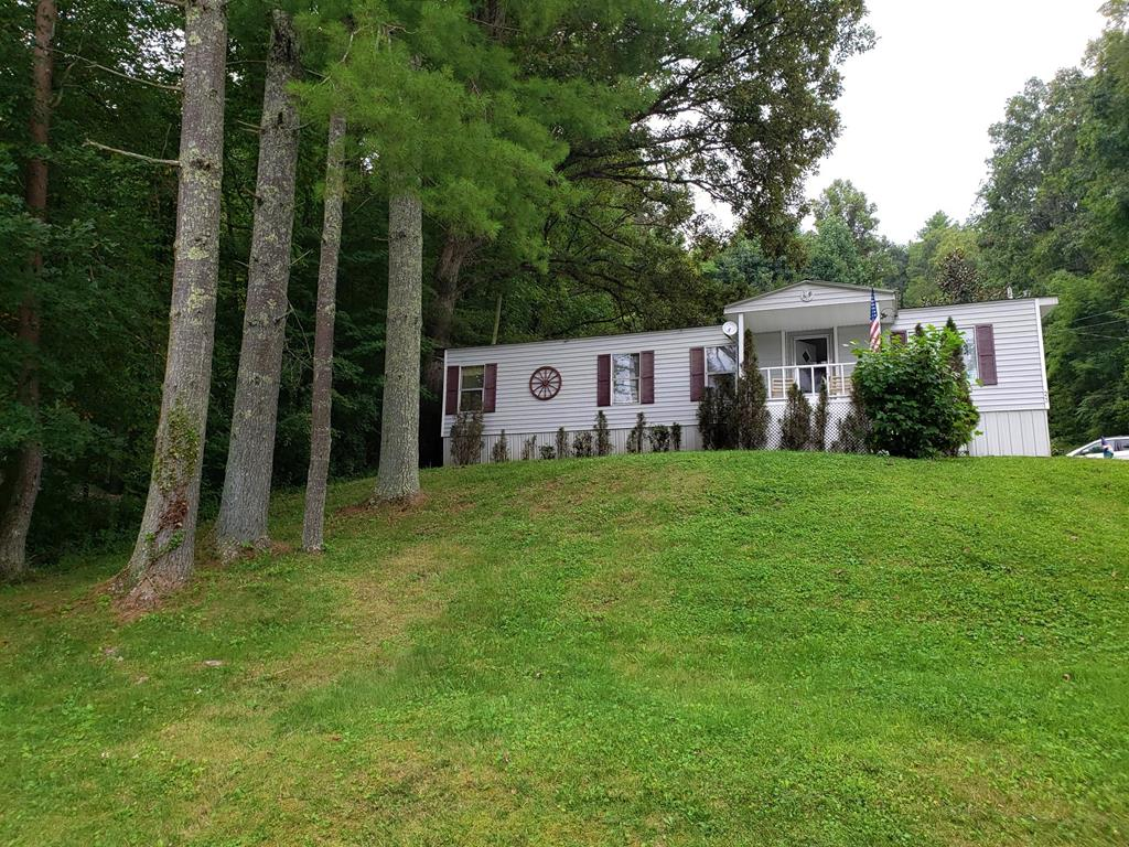 This Well Maintained, One-Level Living, 2-Bedroom, 1-Bath Manufactured Home Located in Murphy. Public Water / Sewer & Trash Pick-up. On Paved Road Just Minutes from Town. The Large Open Kitchen w/ Breakfast Bar open to a Huge Dining Room. The Living Room in Bathed in Natural Light and Exits onto the Covered Front Porch. Master Bedroom Easily Accommodates a King Size Bed, Dresser and End Table. The 2nd Bedroom could be used for an Guest Room of Office. New Vinyl Siding Installed Over Additional Layer of Insulation. The Bathroom Features a Roman Tub, Walk-in Shower and Double Vanity. Laundry Room w/ Washer & Dryer. This Comes Furnished and is Move-In ready. Come and See for Yourself !