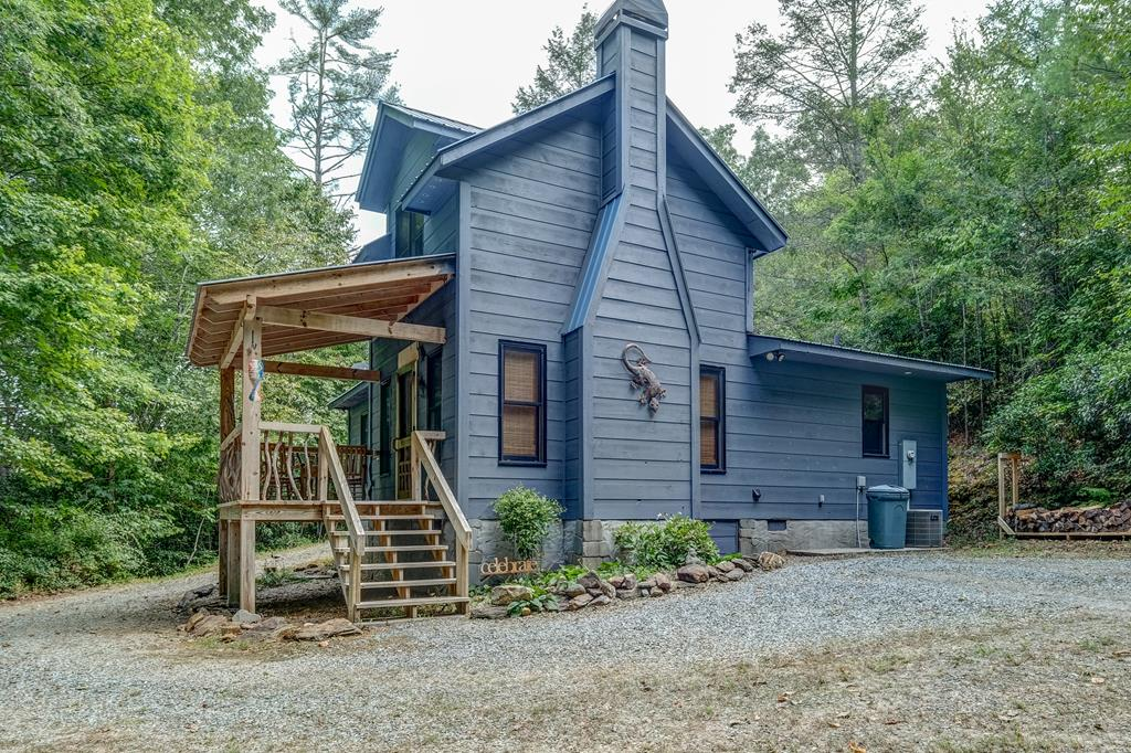 Incredibly rare find! PRIVATE Modified Timber Frame Cabin on almost 3 UNRESTRICTED ACRES with a Creek at the bottom! Impeccable 2 bed/1 bath home has a cozy outdoor patio that is a great place to BBQ or relax. Inside is your living room with timber beam ceiling, tile floor and a copper cased mantle above the wood burning fireplace. Your kitchen hosts knotty pine cabinets with marbled stain glass doors on the uppers, SS, tile countertops, breakfast bar and an incredible farm sink salvaged from an old schoolhouse. Main floor bedroom has gorgeous wood flooring and double closets. Upstairs to your 2nd bedroom with wood flooring, built in shelving & closet. Shed for tools. THIS IS ONE SWEET HOME!
