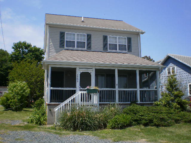 Gorgeous views of Assateague Island and the Lighthouse! 2 waterfront parcels across the street are included. Open floor plan, plenty of room on the spacious screened front porch. Cute backyard for outdoor grilling. New roof, 2016. Home is a vacation rental, so it is an established income producer. Don't miss this opportunity to own a piece of waterfront heaven on Chincoteague Island. New heat pump installed summer 2017.