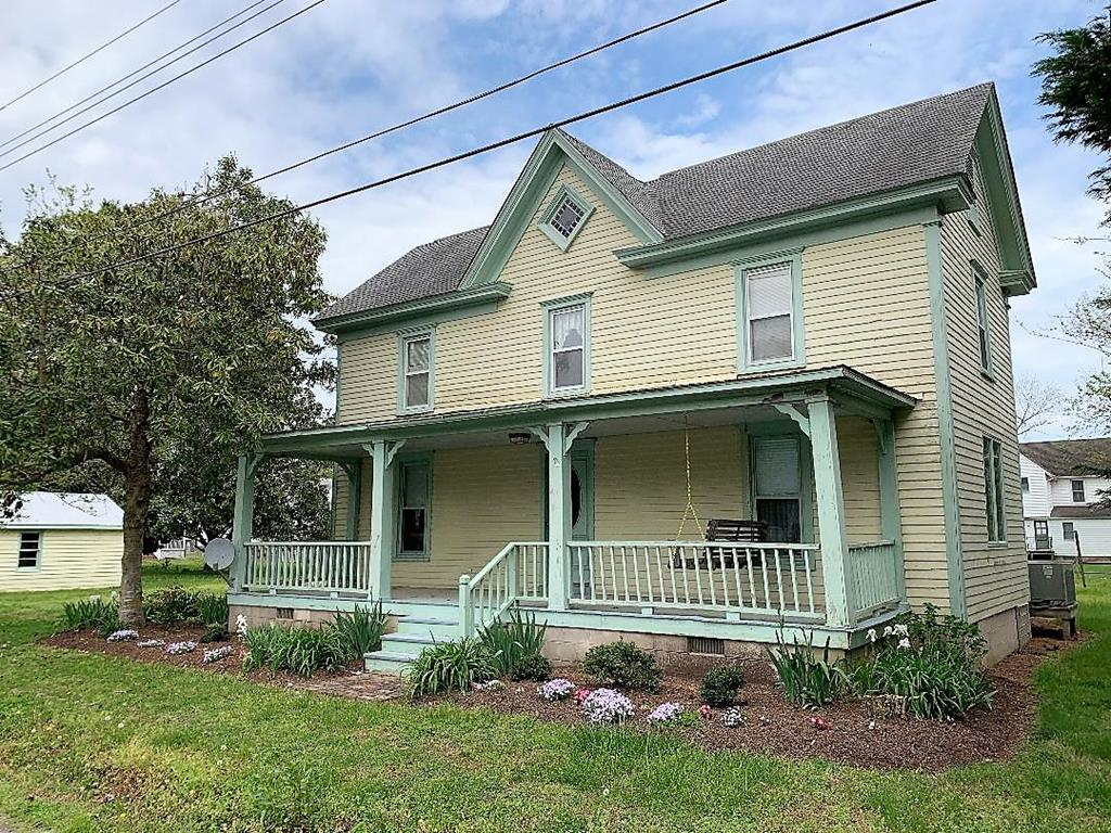 Located in the heart of Wachapreague, this historic charmer is a seaside retreat. Living is easy on the Eastern Shore and this home makes it possible to live here, would make an excellent fishing retreat, vacation rental or a just a great place to call home. Plenty of space with 2 town lots, detached garage and fish cleaning shed. Easy walk to marina and in town attractions. With 4 Bedrooms and 2 baths there is plenty of room for family and guests. Open concept kitchen, dining and living room. Wonderful screened in porch for picking crabs and breezy front porch complete with swing.