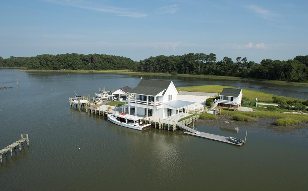 SALT GROVE POINT on Cherrystone creek at Eyrehall Creek. A spectacular deep water peninsula with an island like marina and home site, a premiere sportfishing wharf and extraordinary recreational marine compound. Includes a custom crafted historic restoration of traditional building with shellfish packing room and beautiful upstairs oyster watch house with full bath overlooking multiple boat slips, and a deep water wharf suitable for a boat basin. Includes an on site boat launch ramp, an engineered  40'x60'concrete pad with utilities ready for a primary residence, an 18'x30' foundation for other water dependent structure/building, landscaped clamshell parking lot, small one room office building. Minnow farm tenant on year to year lease. See Misc Docs & Video Tour link.