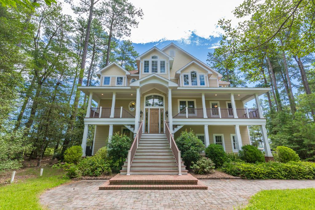 Dramatic 3-story home with views of the marsh to the ocean.  Private gated community with caretaker and boat shuttle service to 2 undeveloped barrier islands (Metompkin and Cedar Islands) with miles of natural beaches! Waterfront on Folly Creek. Dock with 16, 000 lb solar powered boatlift. Hardwood floors throughout, granite, SS appl, screened in porch.  Breathtaking views w/floor to ceiling windows!