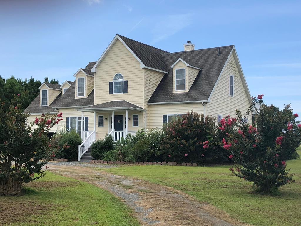 REDUCED-SEE ULTIMATE SUNSETS overlooking the Chesapeake Bay. Lovely Contemporary Cape with 5 acres of pristine land. Experience the light filled rooms, cathedral ceilings, cherry wood floors, Kitchen with cherry cabinets and breakfast bar -  semi open to living room with french doors leading out to the newly designed deck.  Beautiful bright Sunroom off the kitchen. Cathedral ceiling living room with custom bookshelves, surround sound, fireplace and the View!  First floor Master Suite with more french doors to the view, double vanity and jet tub.  Second floor 2 bedrooms with large closets and bonus/bedroom over the garage. New Storm doors on all 3 French doors. The home is surrounded by beautiful perennials, knock out roses, oleanders, crepe myrtles.Community Beach. (Measr. are approx.)