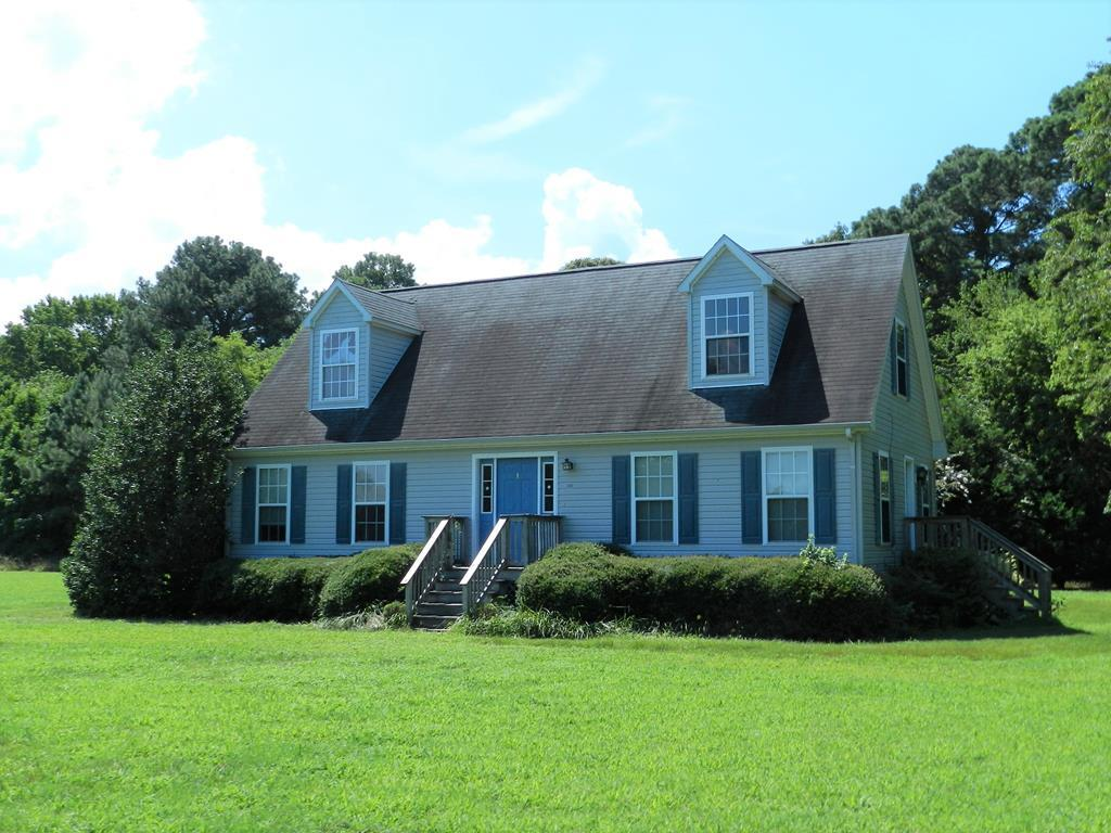 Cute Cape Cod in community with Beach, Pool, Tennis & Boat Ramp. Private setting with woods on 2 sides. Very close to beach access.  Come and enjoy the pleasant Eastern Shore life at this home close to the beach and other community amenities. Two bedrooms downstairs and two up make this a great home. Enjoy the fire pit in backyard during the cool Fall nights. Use the community boat ramp to access Hungar's Creek and the Chesapeake Bay for some great fishing!