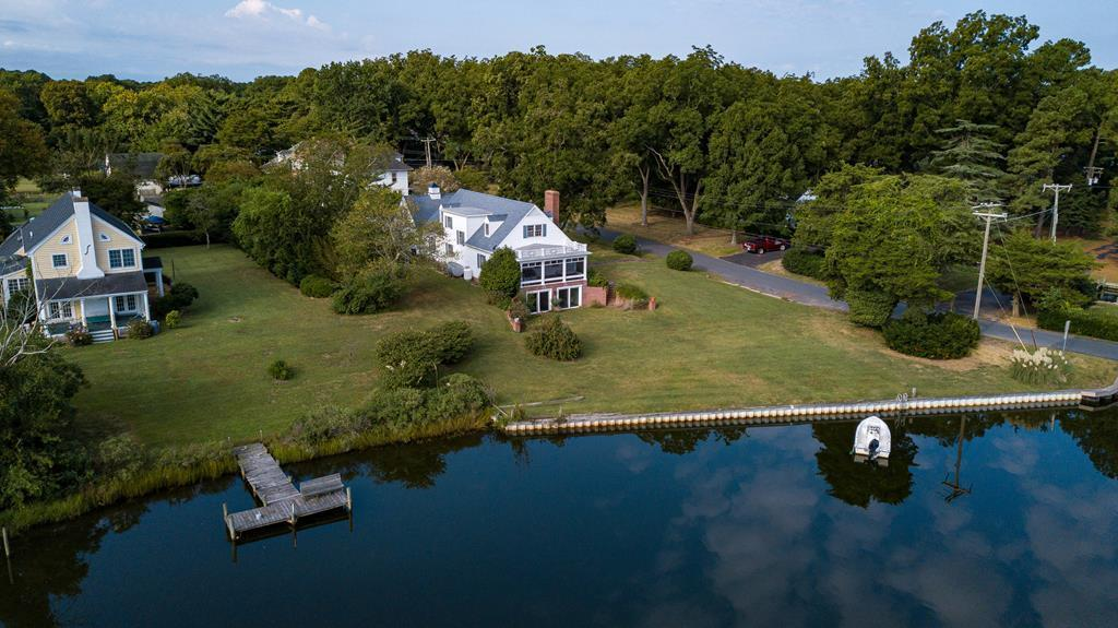 See an amazing tour of this home at https://my.matterport.com/show/?m=aAjkYmPzqr4&mls=1  to experience the wonderful features of this proud Mount Prospect waterfront home. From the elevated screen porch, you can soak up the sights & sounds of Onancock wharf & creek. You will constantly be tempted  to kick back & enjoy the vibes of of this great in-town location. This classic, solid home offers charming hardwood floors, an elegant 3-story staircase, 2 fireplaces, treasured style details, family friendly spaciousness, huge rooms, & lots of storage. You'll find 2 first floor bedrooms and 2 upstairs bedrooms make for a perfect arrangement. Finished walk-out basement leads you right to the water and has a large room with a cozy fireplace and enclosed porch.. Super efficient heat system.