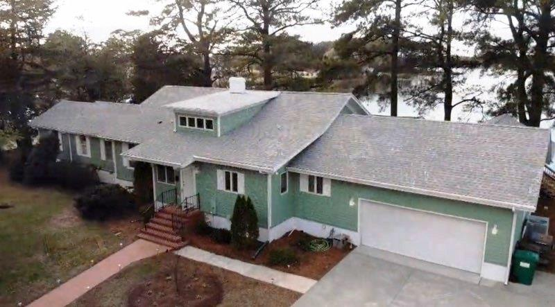 OPEN HOUSE 12/14 1pm-4pm This unique waterfront property offers what are the most important aspects of ownership...location, superb condition, all the amenities, including in-town and deep water.  Situated on a hill with unsurpassed views is this 4BR/3BA 3500 sq ft home.  All rooms enjoy great waterfront views and open floor plan. Well appointed kitchen with all appliances, granite countertops, abundant cabinetry & laundry room. Attached garage with handicap lift.  Basement, several outbuildings, dock with 2 boat slips and 1 lift.  A Boat house finished to enjoy for entertainment or as a guest area in season. Located within a short boat ride to the Chesapeake Bay and only 2.5 miles to Onancock's new hospital. The original section of the home was a 1920's Sears-Roebuck home.