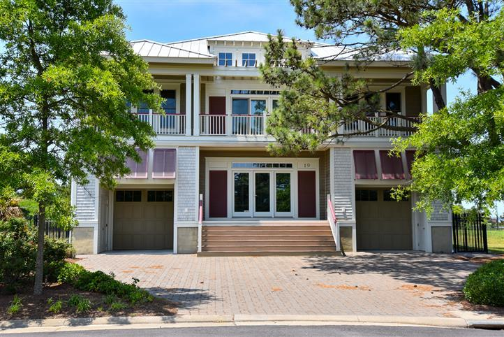 GRAND BAHAMA STYLE CONTEMPORARY - In the Bay Creek community of Marina Village East with beach and pool access. Expansive Sunlite Rooms facing Sunsets. Each Bedroom with its own en-suite bath and surrounding a media room. Terrific for family get togethers or gathering rental. Large family room with fireplace wraps into kitchen and dining area. Large kitchen, 2 large granite islands, wine coolers , mood lighting throughout. Wonderful space for entertaining. Dual upper and lower decks on front and back, plus screened eating porch. Rinnai water heater, large laundry room and appliances, split garages, one for your car and one for your toys. On the edge of Historic Cape Charles, take your golf cart to beaches, shops, restaurants and etc. Solid vaca rental history. (measurements r approx.)
