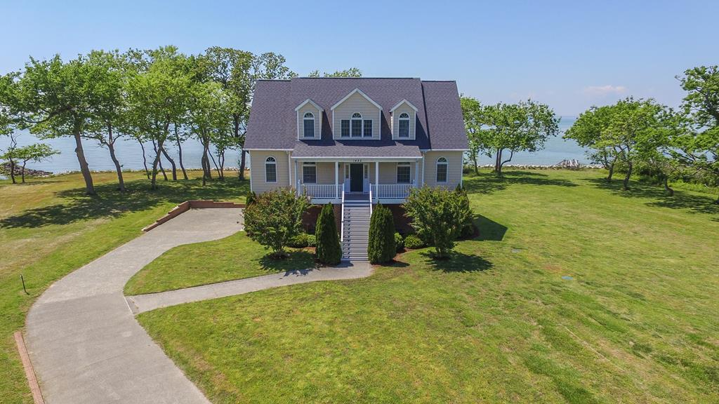 Expansive Chesapeake Bay views from this Charleston Inspired Home. This spectacular home on 3 levels is perfect for a second home retreat, a summer weekly rental or living the coastal lifestyle year round. Just 35 mins across the bay to Va Beach and Norfolk, and just 12 mins south of the charming bayside town of Cape Charles. You will love the peace and quite ..... and fabulous sunset views across the Chesapeake. Great for star gazing and ship gazing. Kiptopeake Sate Park boat launch and fishing pier is just 8 mins away. Start Living the Coastal Lifestyle on the Eastern Shore of Virginia.