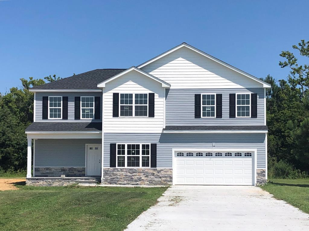 NOTTINGHAM ESTATES. Just south of  Historic Cape Charles and 5 min. from the Chesapeake Bay Bridge Tunnel.  This new construction home has an open concept Kitchen to Living room with fireplace and 9'ceilings. L shape floor plan allows dining room to be separate yet open. Large kitchen bar for stools and socializing. Two car garage, laundry on the 1st floor. Upstairs 4 bedrooms, walk-in closets, Master bedroom with tray ceilings and en suite bath.  Short distance to Kiptopeke State Park beaches, fishing pier, and boat ramp. 10 minutes to Cape Charles beaches, restaurants, shops, golf and marinas. An Excellent value, more affordable than ever with near record LOW INTEREST RATES from banks and mortgage companies anxious to help make this your new home. (all measurements shown approx.)