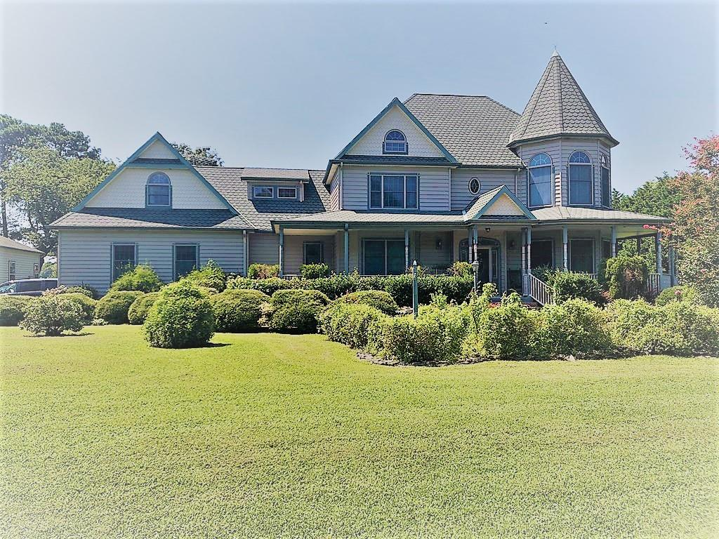 Custom built waterfront home on a high point with panoramic views of the Chesapeake Bay... Westerly views &  majestic sunsets. 3,400 sq. ft. home is in excellent condition & boasts wraparound porch, detailed wood molding, handsome hardwood floors & custom winding staircase. Spacious man-cave w/private back stairs. Enjoy 300 ft. private pier in backyard next to staircase leading to your own sandy beach. Attached 3 car garage, 5 component generator, 1200 sq. ft. boat garage w/bayview multipurpose room. An additional garage/out building w/ space overhead could be converted to small apartment. Mature landscaping & attention to detail makes this truly a home to enjoy w/ your family and friends. Ten minutes to Cape Charles with beach, marinas, golf, shops, restaurants and galleries.