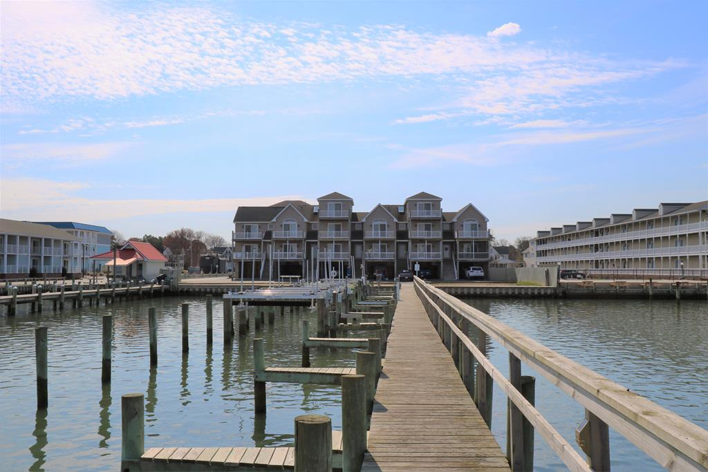 Views... Views... Views! This town home at Waters Edge will leave you in awe while staring at the gorgeous uninterrupted bay views and sunsets. Onsite is a community dock with great fishing and crabbing along with your own private deep water boat slip (#3). From the time you get into this home from your protected parking area, you will feel right at home. The first level features sprawling wood floors throughout, a gas fireplace with an open floor plan, powder room and two decks. The kitchen boats gorgeous granite counters and SS appliances. Upstairs you'll welcomed by an open landing and lots of natural light. There are two spacious bedrooms each with a private deck, 2 bathrooms and laundry. The master features en-suite bathroom and private waterfront deck.