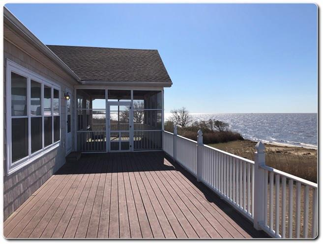 This beauty overlooking Pocomoke Sound along with your own beach in Historically listed Saxis is just what the Doctor ordered.  Sit on your deck or in your screened porch and see what the fisherman are catching, maybe just watch the waves or the tide roll in.  Perhaps you just want to sit on your sofa and look at the view, that will work too.  Come see for yourself, and yes this is on high ground and the first level is built for flood insurance, no worries there.  Set on concrete pilings with the downstairs enclosed and ready for perhaps a pool table or gaming area.  One car or boat garage.  New HD life time warranty-architectural shingled roof.  New refrigerator, washer, dryer and hot water heater.  Custom made front door.  Come See!