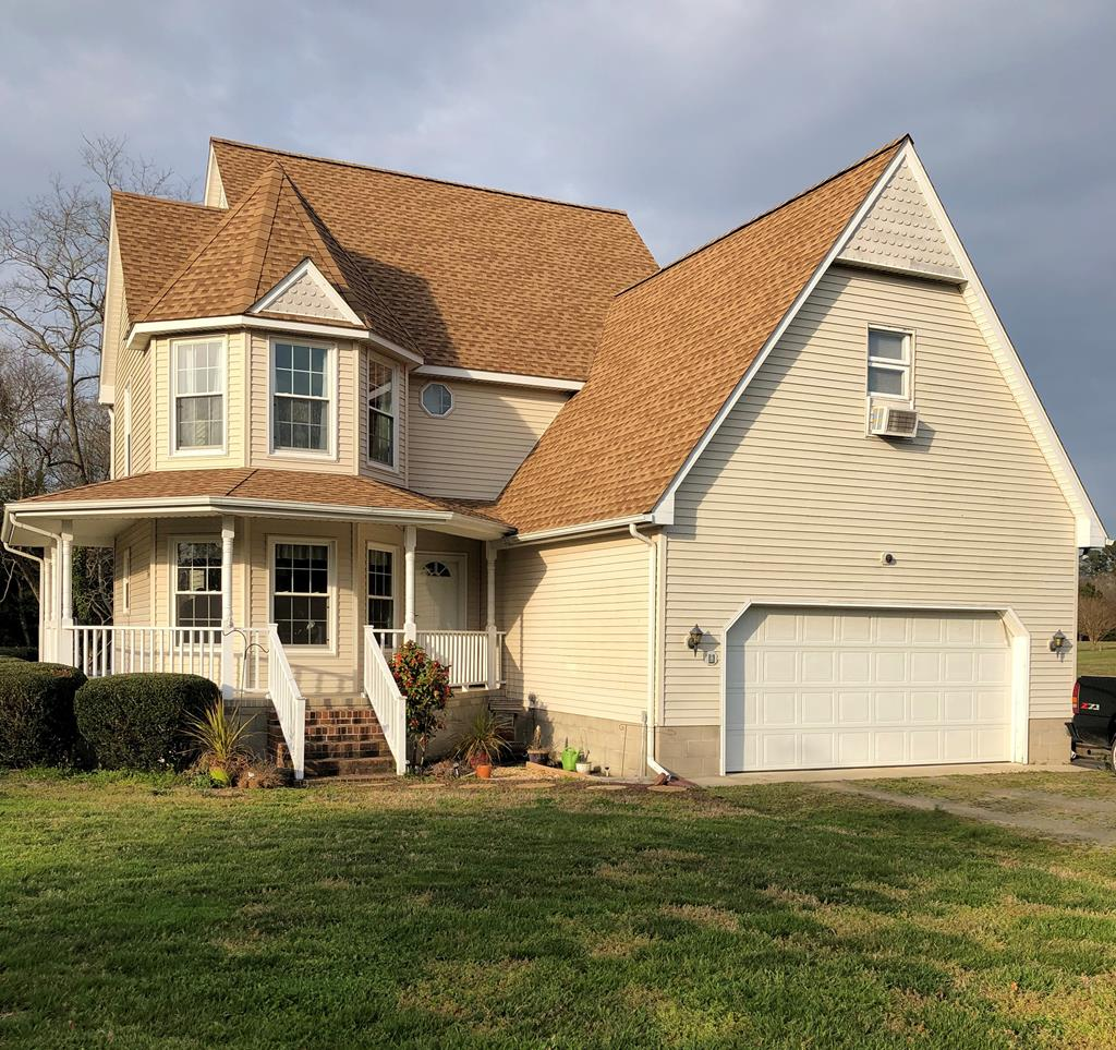 Enjoy coastal living at its finest in this custom built 3 bedroom 2.5 bath home with waterviews of Occohannock Creek.   Large family room w/fireplace and skylights opening to the dinning room and kitchen perfect for entertaining.  Home has had a facelift in 2018  with new windows, kitchen remodel, all new appliances/countertops,  new flooring in  kitchen, 1/2 bath, laundry room and master bathroom, new ceramic tile in foyer, new gas logs, chimney sealed an a new chimney cap. After a long day sit back with a good book and relax on the wrap around porch/deck, enjoy the waterview. Only a few steps away is a community dock bring your kayak or fishing pole. 5 minutes to Public boat ramp.  Central air/heat throughout home  except the bonus room over garage. Motivated sellers